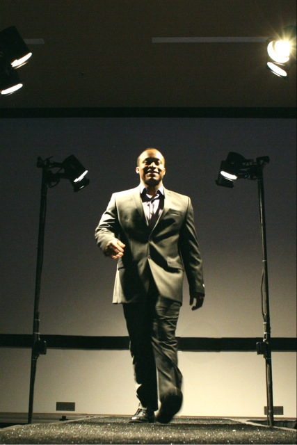Muhammad Muhayim models men's business casual attire.