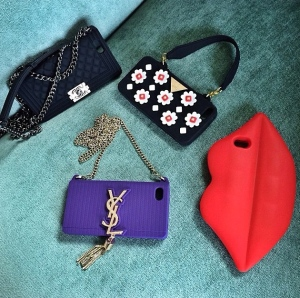 Yves St. Laurent and Chanel are among the designers creating unique phone accessories.