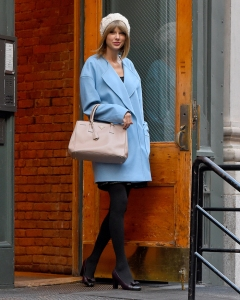 Taylor Swift leaves her home with a powder blue coat and beige Prada bag in New York City